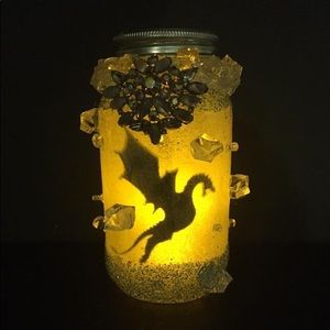 Hand made ice dragon in a jar.